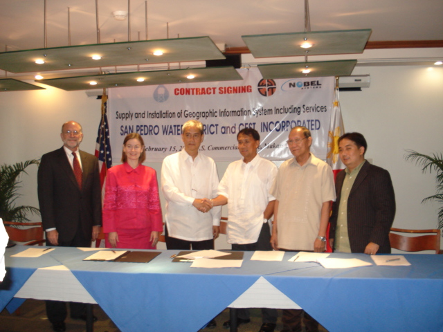 Photo of Nobel Systems of San Bernadino, California at the contract award signing in the Philippines.