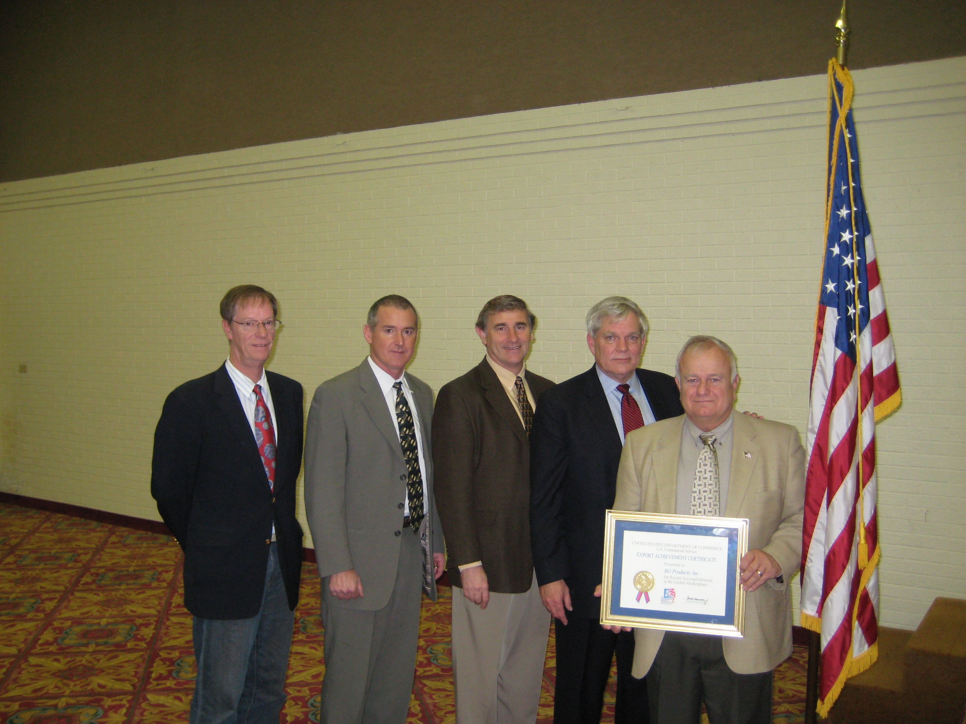Photo of BG Products, Inc. receiving an Export Achievement Award from the Department of Commerce