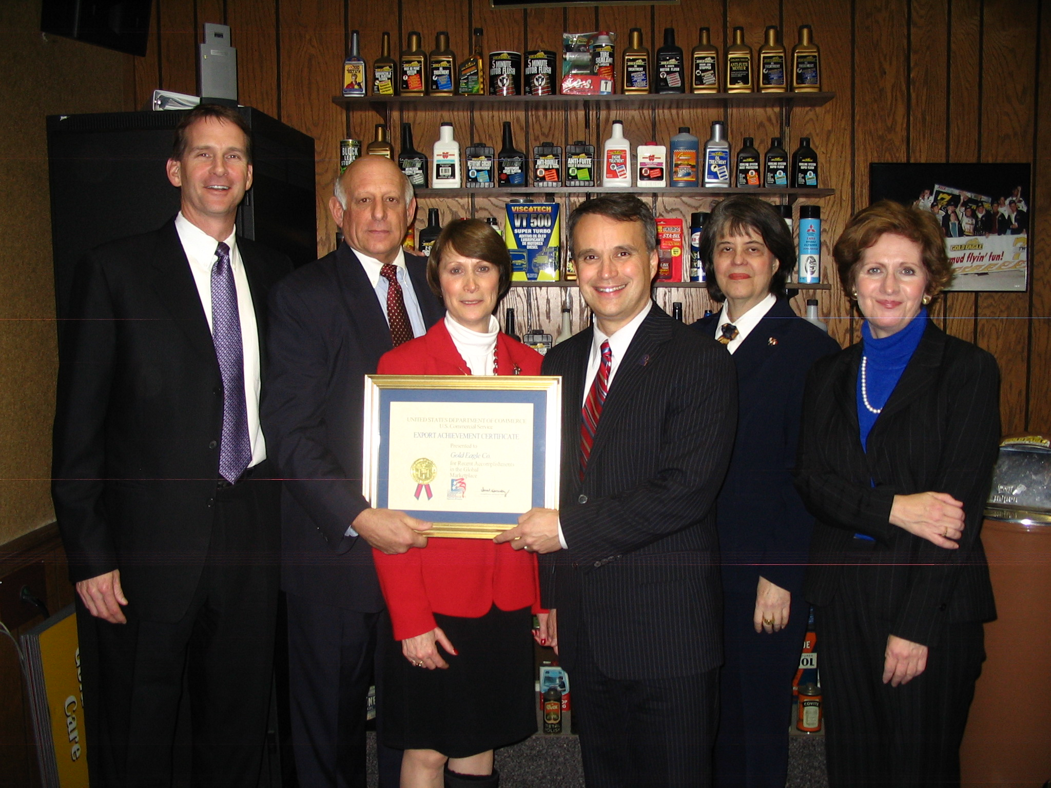 Acting Under Secretary of Commerce Christopher Padilla with members of Gold Eagle